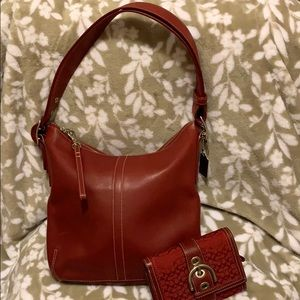 Coach red medium vintage hobo bag with wallet.